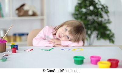 Girl relaxing after classes in pain - Childhood