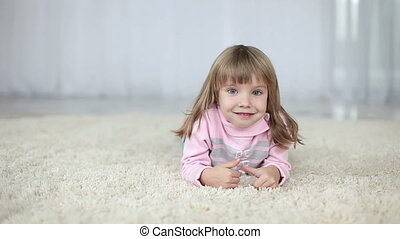 Girl lying on the carpet