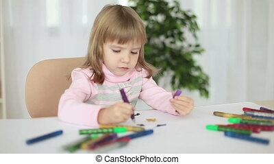 Child draws markers at the table - Childhood