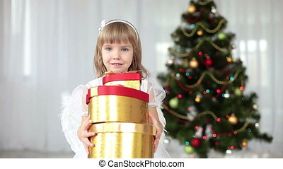 Child with gifts near the Christmas