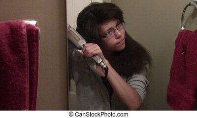 Flat Ironing Hair - Teen flat ironing her hair