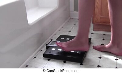 Weighing - Feet stepping on scale