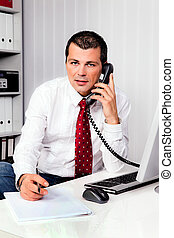 businessman in office with telephone - young businessman...