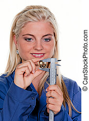 woman as a plumber in blue work clothes - young woman as a...