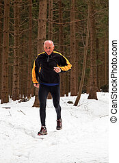 senior running when jogging in the winter - senior-country...