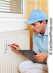 energy savings. reading the heating - fitter with radiator....