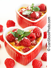 French creme brulee dessert with raspberries and mint...