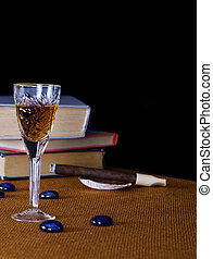 Anti-stress - Crystal glass with cognac and cigar on the...