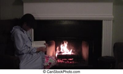 Winter Evening - Teen girl reading by the fire