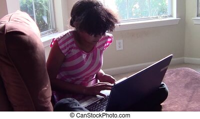 Girl Using Laptop - Girl using laptop in living room
