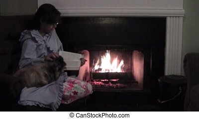 Winter Evening - Teenaged girl reading by the fire
