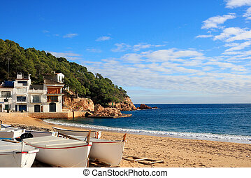 Boats on the beach at Tamariu (Costa Brava, Spain) -...