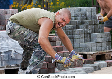 Bricklayer - Paver on job Constructing a new street