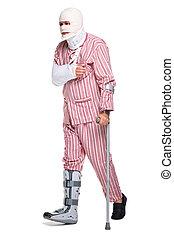 Injured man walking on crutches - Photo of an injured man...