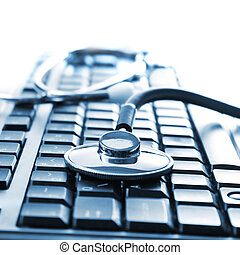 stethoscope on keyboard - Close up photo of stethoscope on...