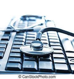 stethoscope on keyboard - Close up photo of stethoscope on...