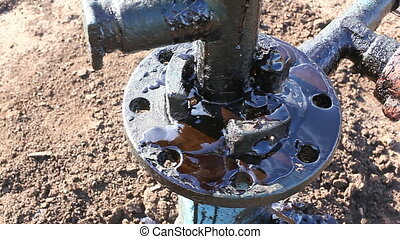 pollution environment - spilled oil from wells on land