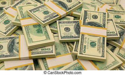 one hundred dollars bundles - spining cash dollars