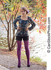 Beautiful girl in purple tights in autumn - Beautiful girl...