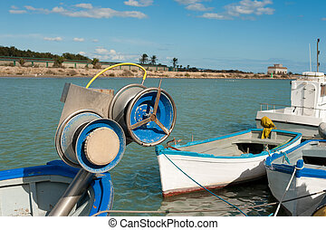 Fishing tackle and traditional small trawlers at a...