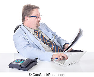 Doctor transcribing examination results - Mature doctor...