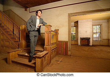 Man Sitting on Stairs in an Old House - Msn in suit sitting...
