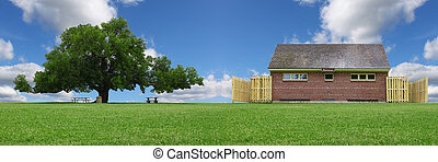 A pano of a large oak tree in a grass field in a park used as a shade tree for picnic tables along with a public restroom on a gorgeous summer day with clouds and a gorgeous blue sky with room for you
