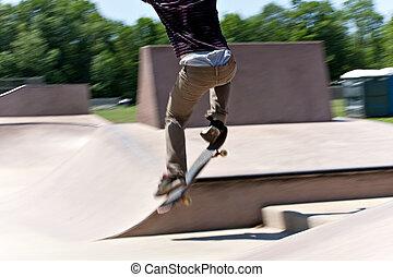 Skater Jumping at the Concrete Skate Park