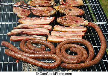 South African Braai - Grilled pork meat, lamb chops and...