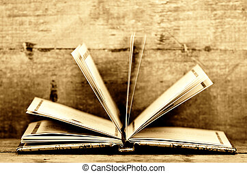 open book - an open book in sepia colors and wooden...