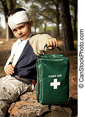First Aid in the Forest - First Aid treatment given to a...