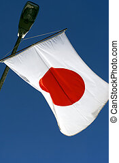 Japanese flag with blue sky background