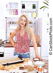Baking cake - Attractive woman baking cake in the kitchen