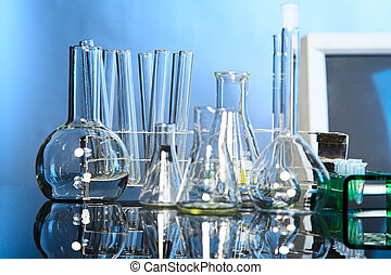 laboratory - Laboratory glassware on blue background with...