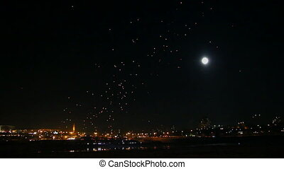 many Japanese Lantern flies over city at night - timelapse