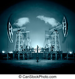 Oil Rigs at night - Two oil pump-jack in action Night view...