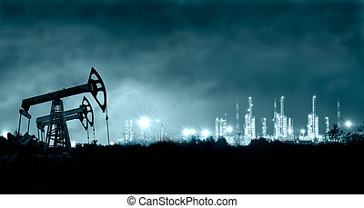 Pump jack and grangemouth refinery at night. - Group oil...