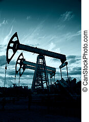 Pump jack - Silhouette oil pumps group on a sunset sky...