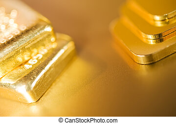 gold ingots - stack of pure gold ingots on a golden...