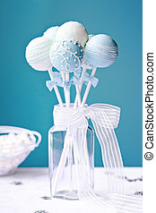 Wedding cake pops decorated in blue and white