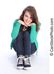 Cheerful blue eyed teenager girl relaxed on floor