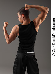 Back deltoid shoulder muscles on fit african man - Deltoid...