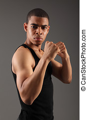 Fist clenched by fit african american man - Fist clenched...