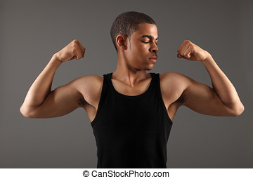Fit body bicep muscles on african american man - Bicep...