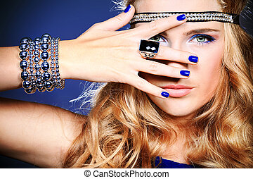 ring - Portrait of a beautiful woman. Jewelry, make-up.