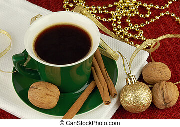 Christmas coffee - Coffee cup with cinnamon, walnuts and...