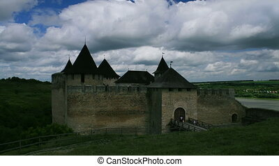 White clouds passing by over an old castle in Khotin, Ukraine