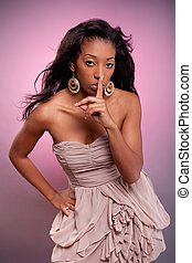 African woman making silence gesture with the finger