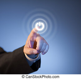 Man's finger pressing virtual power button on touch screen