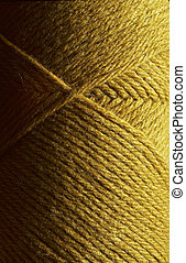 Skein of gold wool knitting yarn
